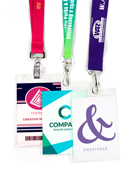 3 colorful lanyards with clear badge holders, holding corporate badges