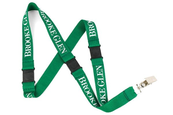 Green polyester lanyard with white text, bulldog clip attachment and 3 safety breaks